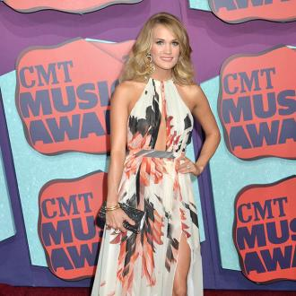 Carrie Underwood Feels Pressure From Unborn Baby