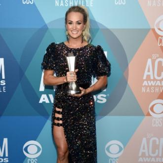 Carrie Underwood and Thomas Rhett make ACMs history as they tie for top prize