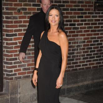 Catherine Zeta-jones 'Thrilled' About Douglas' Emmy Win