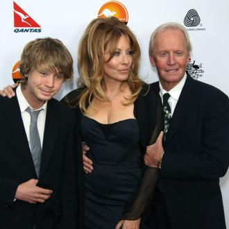Paul Hogan and Linda Kozlowski reunite for their son
