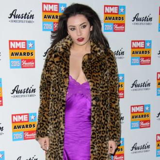 Charli XCX likes 'sweating and being gross'