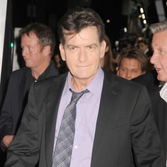 Charlie Sheen won't seek custody of twins