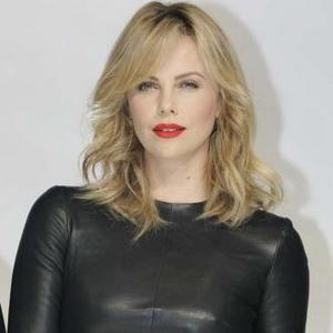 Charlize Theron Gets Baby Help From Dogs