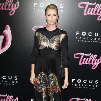 Charlize Theron says too much attention had been given to her appearance in Tully