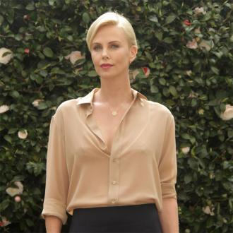 Charlize Theron's mother taught her how to be 'brave'