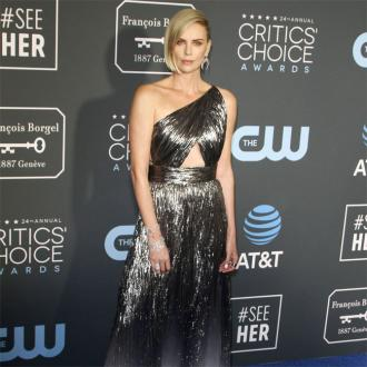 Charlize Theron wants her daughter to tell her own story about her gender identity