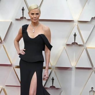 Charlize Theron tells daughter she's dating herself