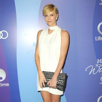 Charlize Theron Wants Tia Mowry Banned From Soulcycle