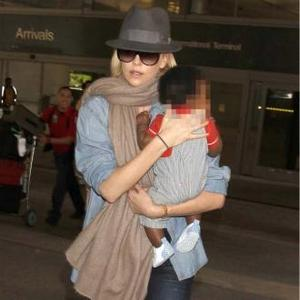 Charlize Theron Watches Tv While Feeding Son