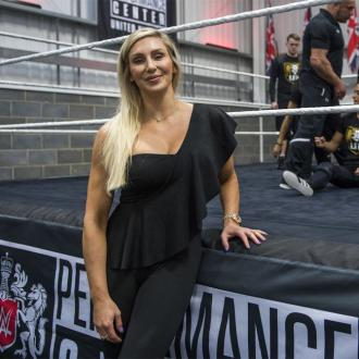 Wwe Superstars Charlotte Flair And Andrade Get Engaged