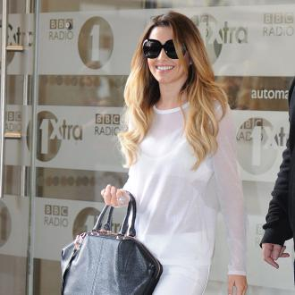 Cheryl Cole Moves Boyfriend Into Her Home