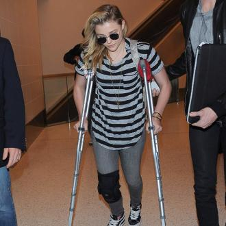 Chloe Grace Moretz wore heels with sprained knee