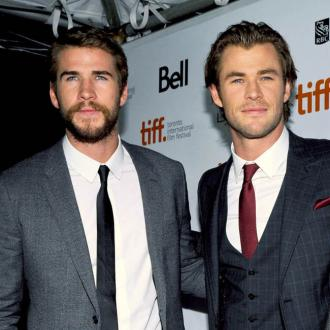 Chris And Liam Hemsworth Are 'Competitive'