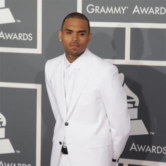 Chris Brown Parties Without Rihanna At Oscars Bash