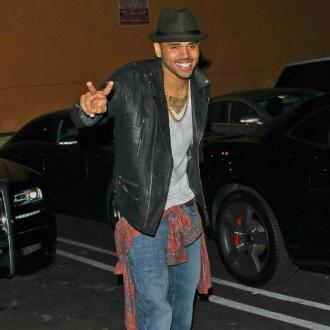 Chris Brown Taking Rihanna Romance Slowly