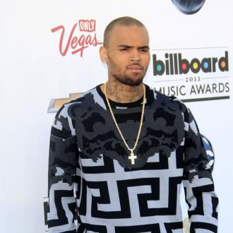 Chris Brown Denies Hit And Run Charges