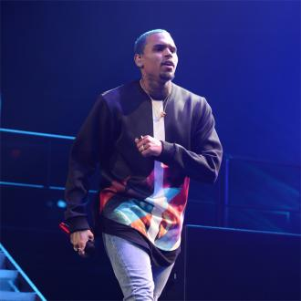 Chris Brown Child Payment War Heats Up