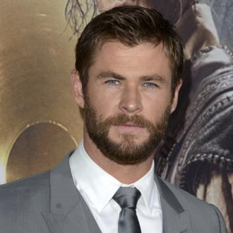 Chris Hemsworth poses for photos with baffled bride