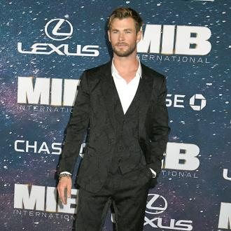 Chris Hemsworth 'went in for a hug' with Brad Pitt during first meeting