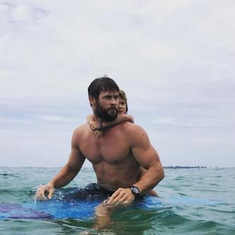 Chris Hemsworth Teaches Daughter How To Surf