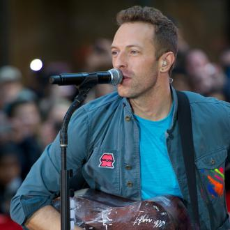 Chris Martin works hard on image