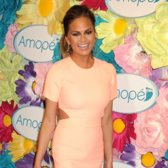 Chrissy Teigen excited for morning sickness