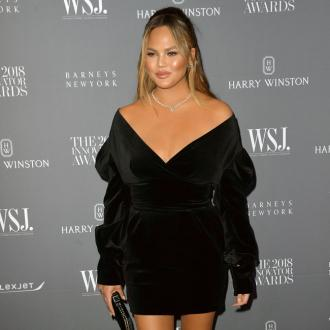 Chrissy Teigen '20 pounds heavier' since having son Miles