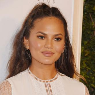 Chrissy Teigen battling stomach virus for over a month