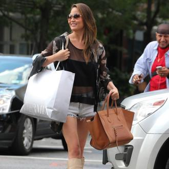 Chrissy Teigen bought designer handbag so she could use store's toilet