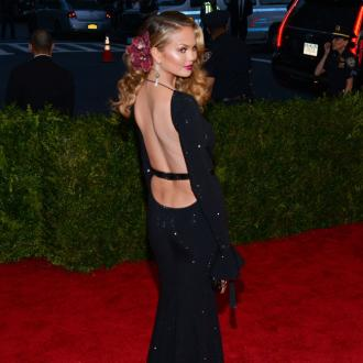 Chrissy Teigen's 'Ultra-feminine Silhouette' At Met Gala