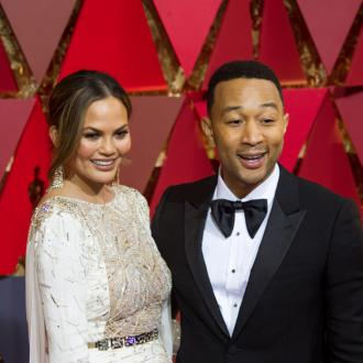 Chrissy Teigen snoozes at the Oscars