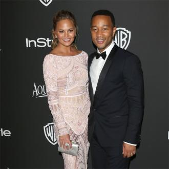 John Legend thinks Chrissy Teigen has a crush on Zac Efron