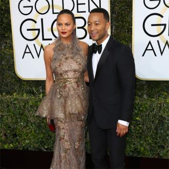 Chrissy Teigen cooking for husband John Legend on tour