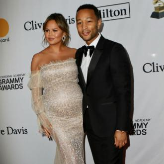 Pregnant Chrissy Teigen jokes baby is trying to kill her