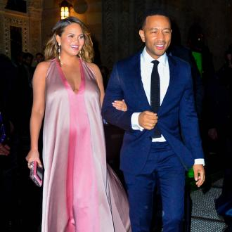 Chrissy Teigen is 'over' being pregnant