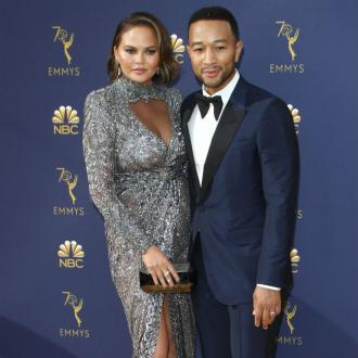 Chrissy Teigen and John Legend celebrated EGOT win with burgers