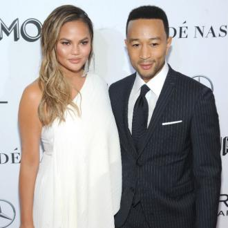 Chrissy Teigen buys a bag for John for Christmas