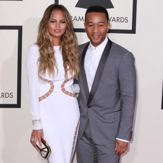 Chrissy Teigen And John Legend Ok With 'Showing Off' Figures
