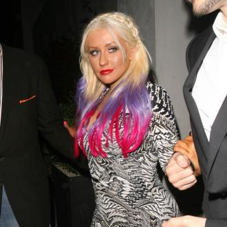 Christina Aguilera Blasts Simon Cowell