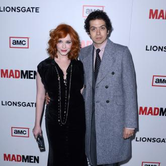 Christina Hendricks Dresses Up For Her Husband