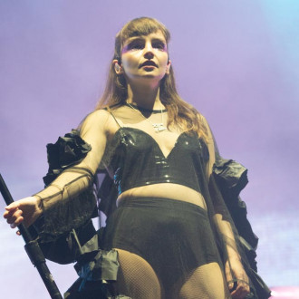 Chvrches tease upcoming collaboration with The Cure's Robert Smith