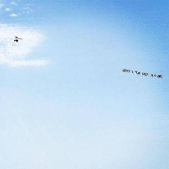 Ciara's anniversary message in the sky