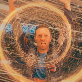 Coldplay perform on alien planet in music video for Higher Power