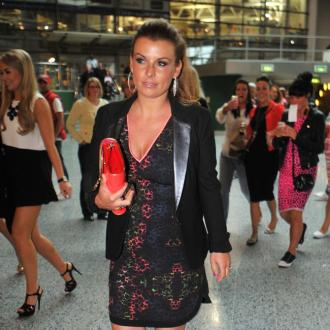 Coleen Rooney's Luggage 'Ransacked'