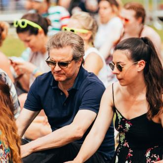 Colin Firth watches son at Isle of Wight Festival