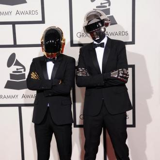 Daft Punk perform with Stevie Wonder at Grammys