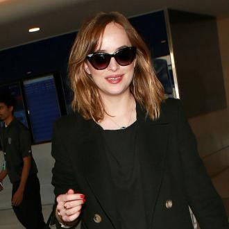 Dakota Johnson 'Happy' With Chris Martin
