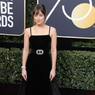 Dakota Johnson says pandemic causes 'costume of depression'