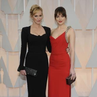 Dakota Johnson takes mum as date to Oscars