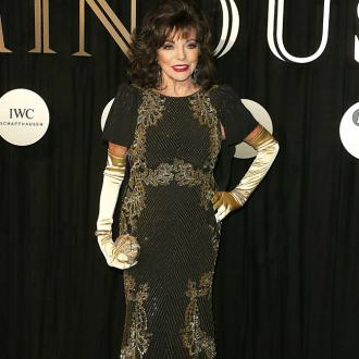 Dame Joan Collins Wears Gloves To Beat The Flu